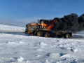 Автогрейдер загорелся на автозимнике «Якутск — Нижний Бестях»